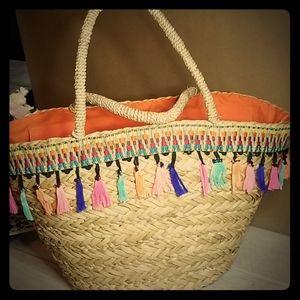Multi colored tassel tan tote bag